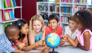 kids playing with the world globe