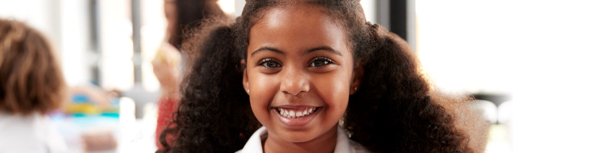 little girl smiling at the camera