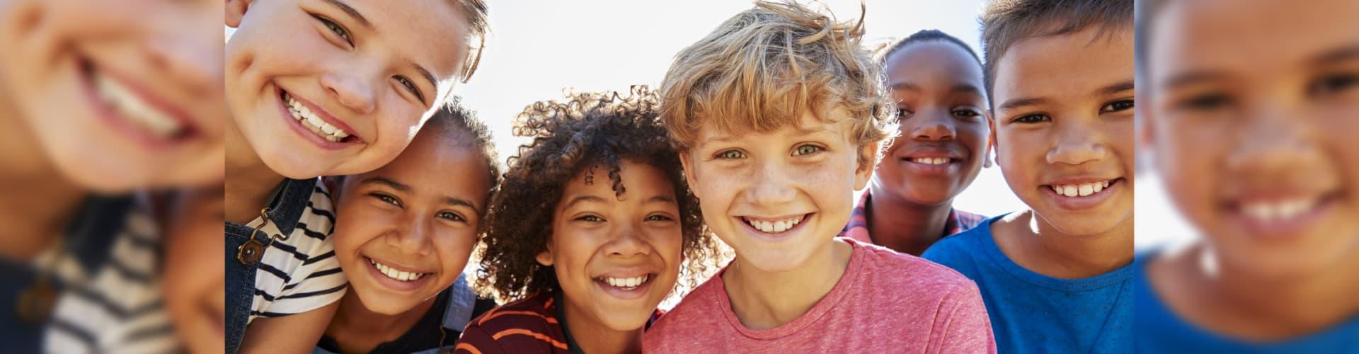children smiling on camera